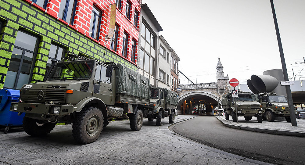 Army trucks stand in the Jewish neighborhood close to the Antwerp Centraal railway station in Antwerp, Belgium on November 20, 2015.