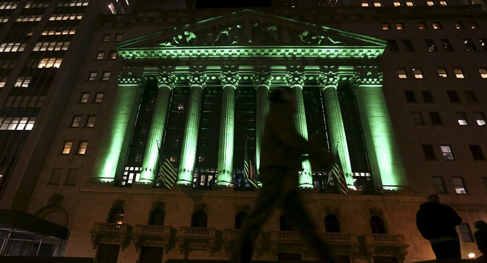 The New York Stock Exchange is lit up in green lights in the Manhattan borough of New York November 12, 2015