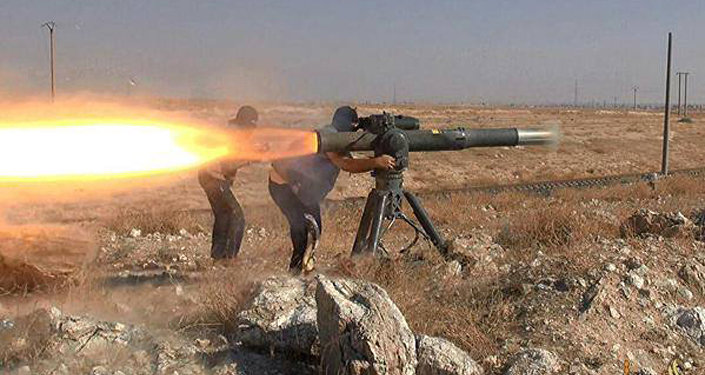 In this picture released on June 26, 2015, by a website of Islamic State militants, Islamic State militants fire an anti-tank missile in Hassakeh, northeast Syria