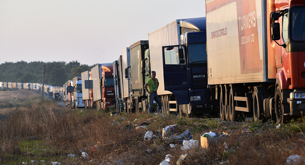 File photo of a man waits next to his truck near to the border crossing point at Kalanchak, on September 20, 2015