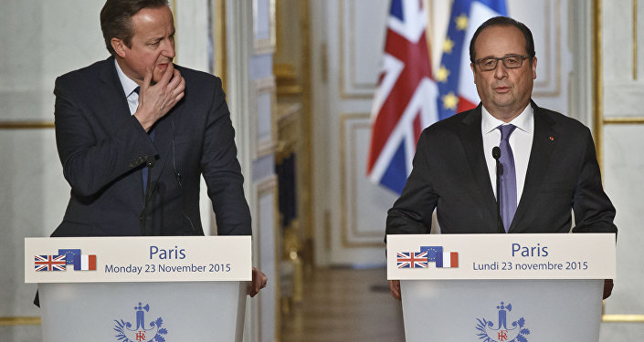 Britain's Prime Minister David Cameron, left, and France's President Francois Hollande issue a joint statement to the media at the Elysee Palace in Paris, Monday, Nov. 23, 2015.
