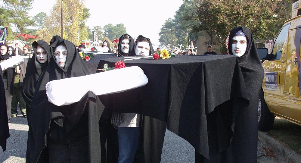 Protesters prepare to march to Fort Benning's front gate Sunday, Nov.18, 2001, in Columbus, Ga., to protest a former Army school they blame for alleged human rights violations against Latin American civilians.