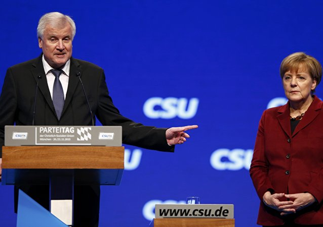 Bavarian Prime Minister and head of the Christian Social Union (CSU) Horst Seehofer welcomes German Chancellor Angela Merkel to the Christian Social Union (CSU) party congress in Munich, Germany in this November 20, 2015 file picture.