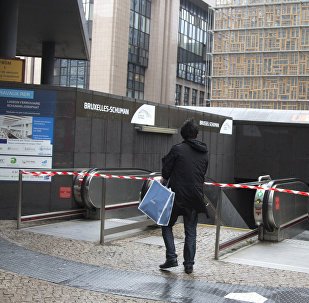 A tourist stops at the blocked entrance of a metro station in Brussels on Saturday, Nov. 21, 2015
