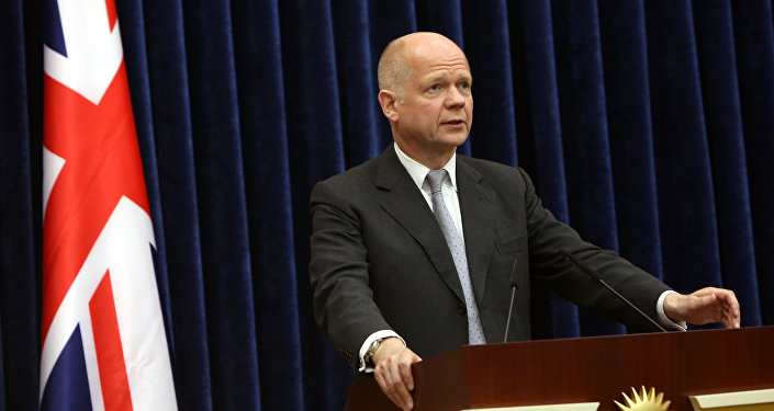 British Foreign Secretary William Hague speaks at a joint news conference with Kurdish President Massoud Barzani in Irbil, a city in the Kurdish controlled north, 217 miles (350 kilometers) north of Baghdad, Iraq, Friday, June 27, 2014.