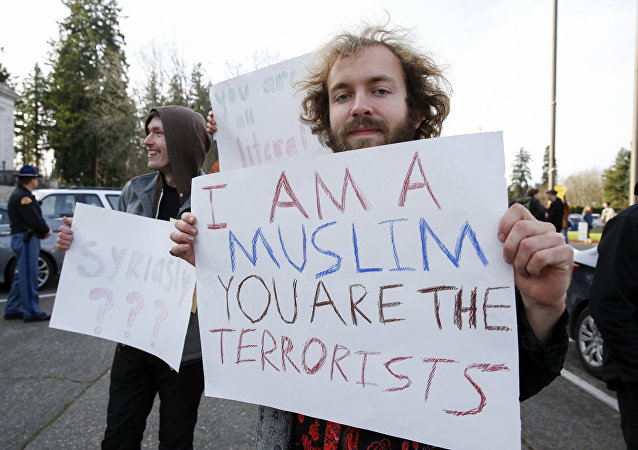 Seth Frow, 20, of Olympia, Washington holds up a sign supporting refugees during a rally in Olympia, Washington on November 20, 2015. The placard reads: I am a muslim, you are the terrorists.