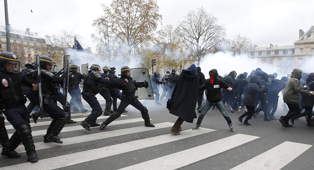 Demonstrators clash with CRS riot policemen near the Place de la Republique after the cancellation of a planned climate march following shootings in the French capital, ahead of the World Climate Change Conference 2015 (COP21), in Paris, France, November 29, 2015