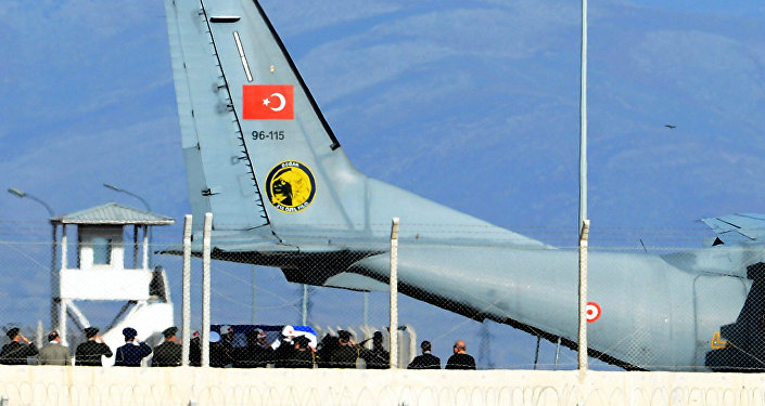 Turkish army officers salute as Turkish honour guard carry the coffin of Russian pilot Lt. Col. Oleg Peshkov into a Turkish Air force transport plane at Hatay airport, Turkey, Sunday, Nov. 29, 2015