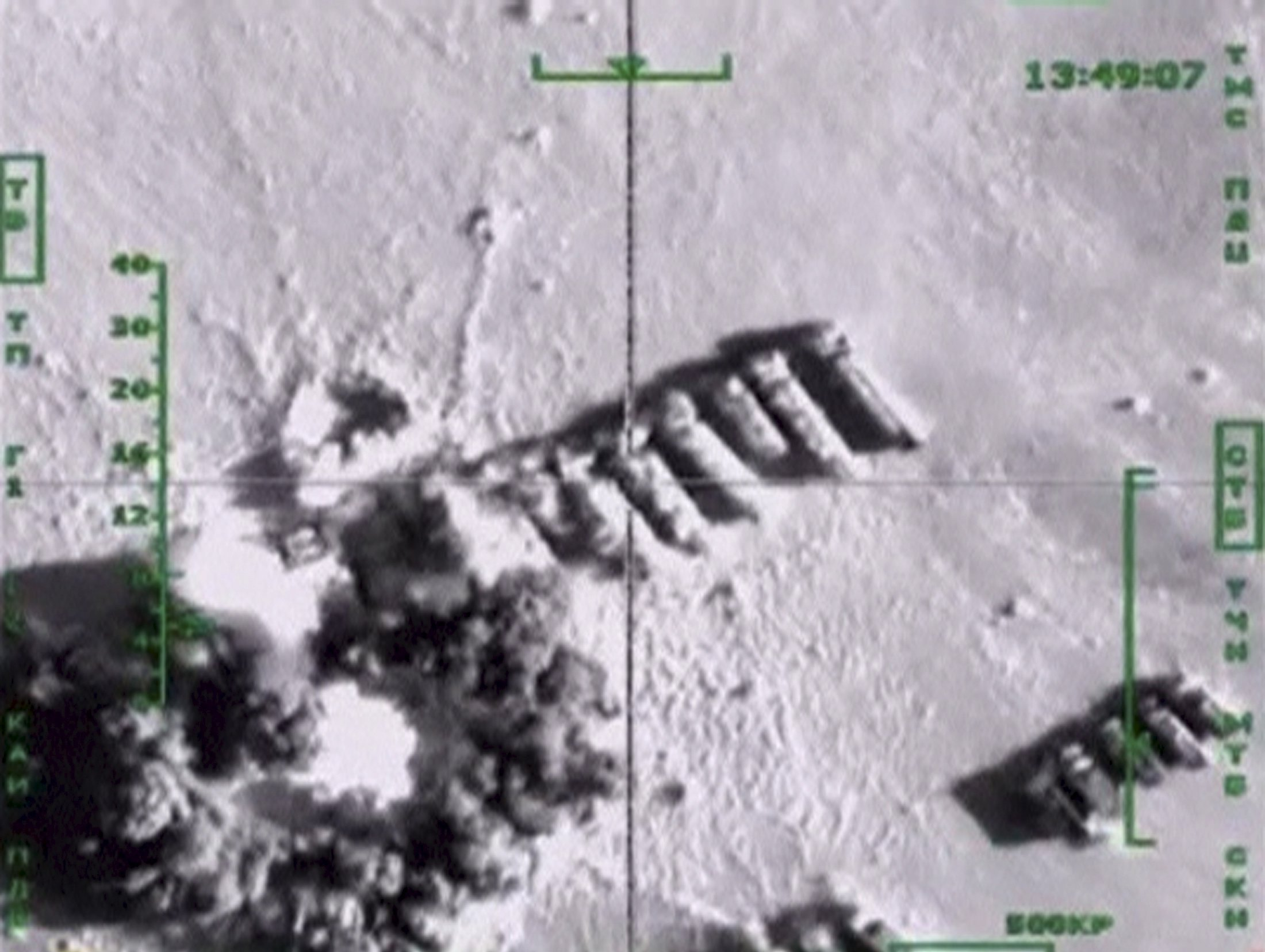 Oil trucks, which, according to Russia's Defence Ministry, are being used by Islamic State militants, are hit by air strikes carried out by Russia's air force, at an unknown location in Syria, in this still image taken from video footage released by Russia's Defence Ministry on November 18, 201