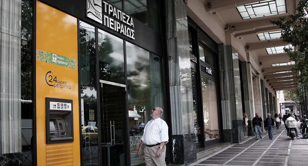 A man locks on branch of PPiraeus Bank in Athens on Tuesday May 29, 2012