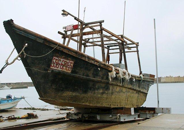 An unidentified wooden boat that was found in the sea off Noto Peninsula is seen in Wajima, Japan.