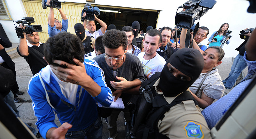 The five Syrian nationals arrested with forged passports leave the court in Tegucigalpa on December 1, 2015 upon being released after paying a USD 500 bail