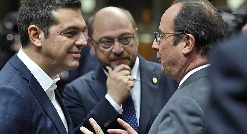 Greek Prime Minister Alexis Tsipras, left, and European Parliament President Martin Schultz listen to French President Francois Hollande, right, during the EU summit in Brussels, Belgium on Thursday, Oct. 15, 2015.