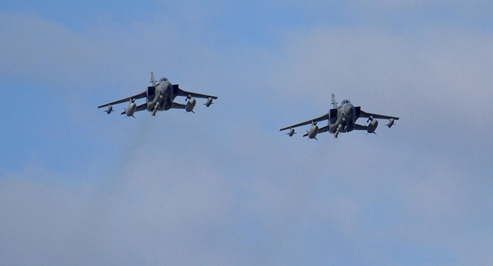 Two British Tornados warplanes fly over the RAF Akrotiri, a British air base near costal city of Limassol, Cyprus, Thursday, Dec. 3, 2015, as they arrive from an airstrike against Islamic State group targets in Syria