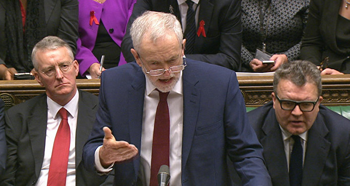 Opposition Labour Party leader, Jeremy Corbyn, center, stands as he makes a speech to lawmakers inside the House of Commons in London, during a debate on launching airstrikes against Islamic State extremists inside Syria, Wednesday, Dec. 2, 2015.