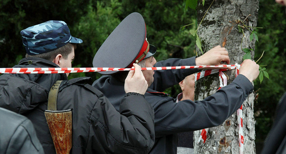 Law enforcement officers conducting a raid to seize a group of militants in Nalchik