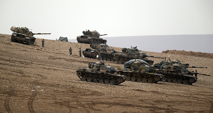 Turkish soldiers hold their positions with their tanks on a hilltop on the outskirts of Suruc, at the Turkey-Syria border . file photo