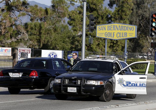 A police officer stands on the street outside the Inland Regional Center following Wednesday's attack in San Bernardino, California December 5, 2015.