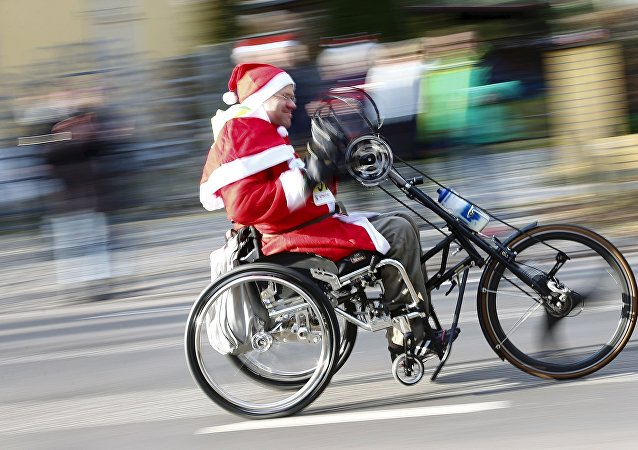 A handicapped man dressed as Father Christmas participates in the Nikolaus Lauf (Santa Claus Run) in the east German town of Michendorf, southwest of Berlin, Germany, December 6, 2015