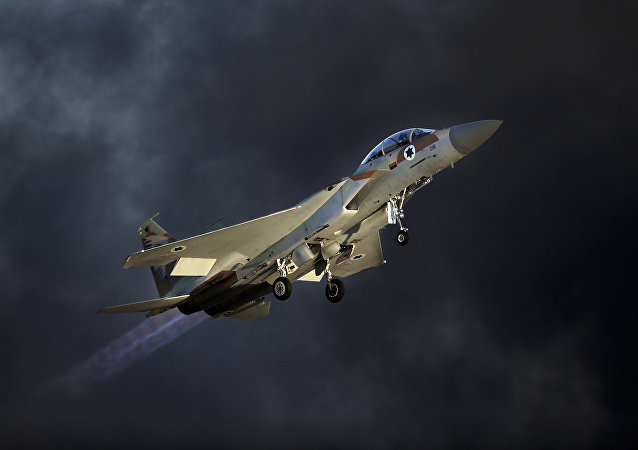 An Israeli F-15 E fighter jet takes off during an air show.