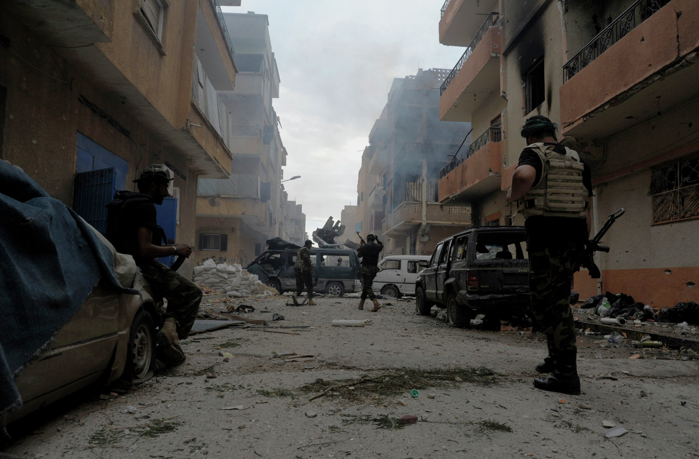 Libyan military soldiers check on an area asLibyan military soldiers check on an area as they battle with Islamic extremist militias in Benghazi, Libya, Thursday, Oct. 30, 2014.  they battle with Islamic extremist militias in Benghazi, Libya, Thursday, Oct. 30, 2014.