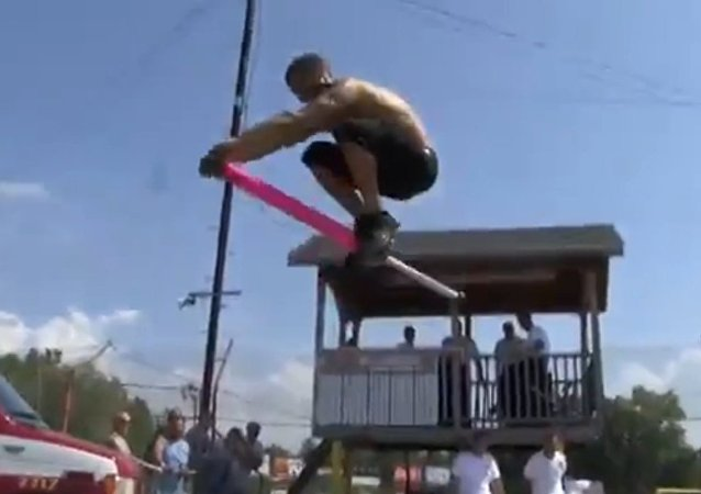 Man faceplants cement after bouncing on pogo stick