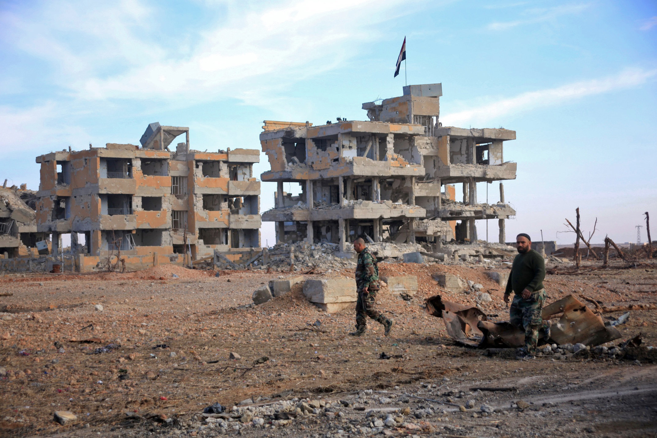 Syrian army soldiers patrol the countryside of Deir Hafer, a former bastion of Daesh, near the northern Syrian city of Aleppo on December 2, 2015