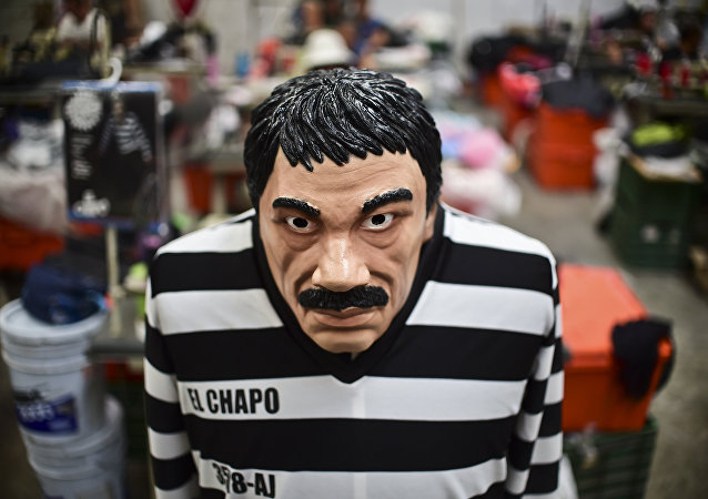 A costume and a mask representing Mexican drug trafficker Joaquin Guzman Loera, aka El Chapo, are pictured in a factory of costumes and masks, on October 16, 2015, in Jiutepec, Morelos State