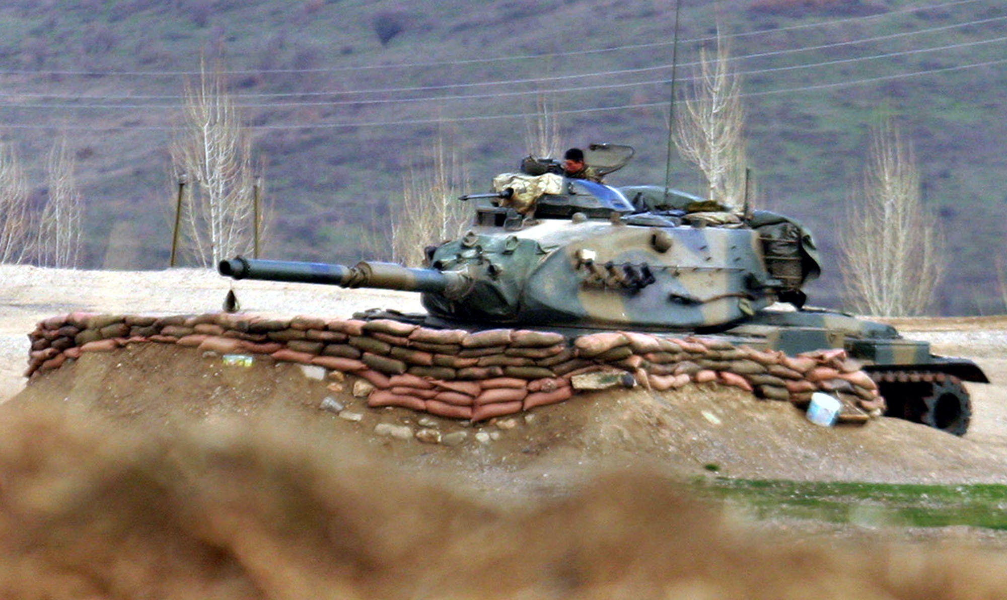 Turkish Army tank stands ready near the village of Bamarni in northern Iraq, 30km beyond the Turkey-Iraq border