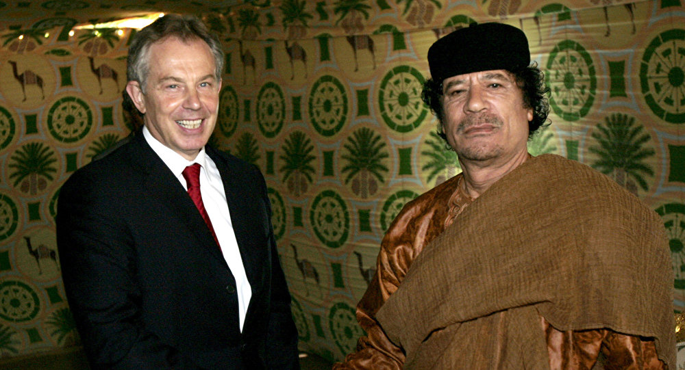 In this Tuesday May 29, 2007 file photo Britain's Prime Minister Tony Blair, left, meets Libyan leader Moammar Gadhafi, at his desert base outside Sirte south of Tripoli.
