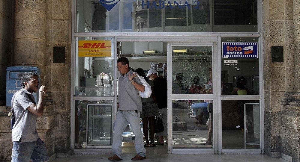 A man leaves a postal office in Havana, Cuba