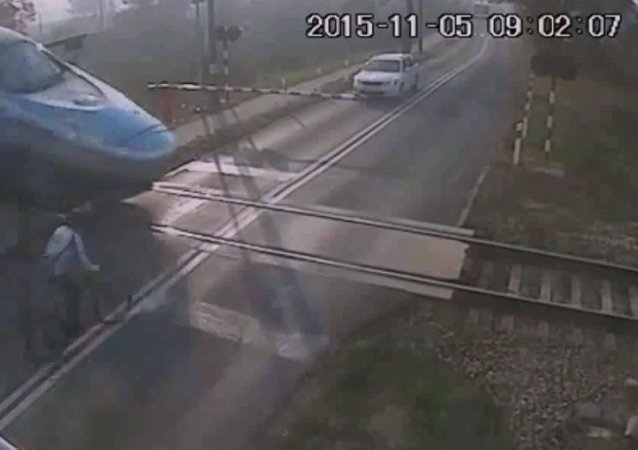 Guy rides a bicycle into a speeding train.