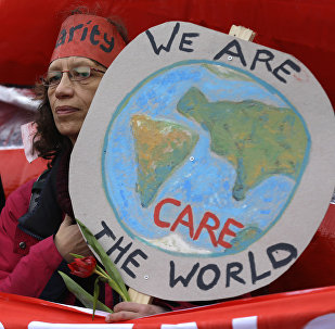 A climate activist demonstrates in Paris, Saturday, Dec.12, 2015 during the COP21, the United Nations Climate Change Conference.