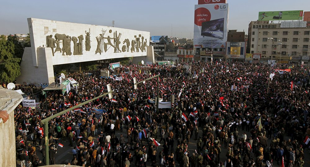 Protesters shout slogans during a demonstration against the Turkish military deployment in Iraq, at Tahrir Square in central Baghdad, Iraq, December 12, 2015