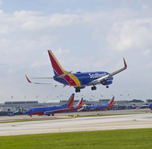 A Southwest airlines plane lands at Chicago's Midway Airport in Chicago on Sepetmber 24, 2015.