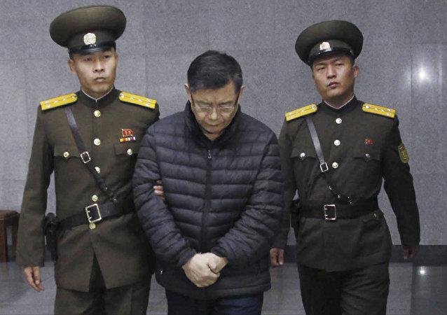 Hyeon Soo Lim, center, who pastors the Light Korean Presbyterian Church in Toronto, is escorted to his sentencing in Pyongyang, North Korea, Wednesday, Dec. 16, 2015