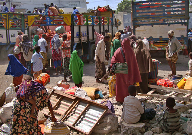 Displaced Somalis who had fled a severe famine in the south of the Horn of Africa country prepare to leave an internally displaced persons camp in Mogadishu January 8, 2012 to resettle back at their respective home regions