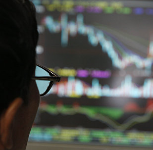 A man examines stock update on a display at a stock brokerage in Beijing, China, Monday, Oct. 6, 2008