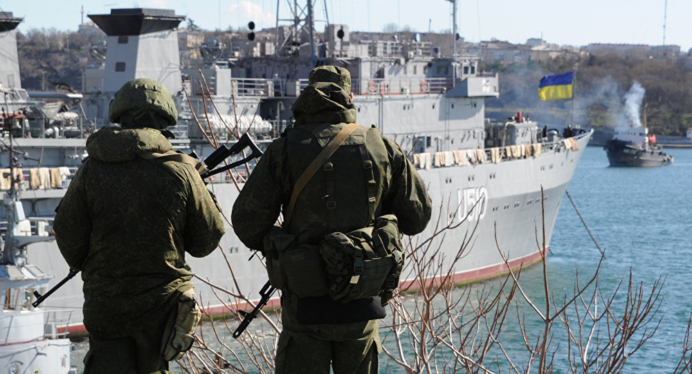 Russian forces patrol near the Ukrainian navy ship Slavutich in the harbor of the Ukrainian city of Sevastopol on March 5, 2014