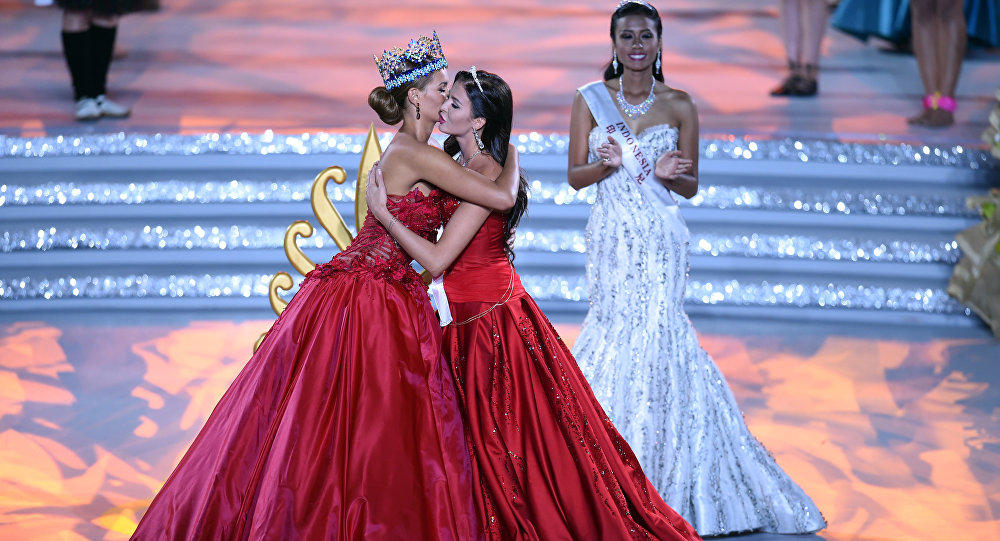 Former Miss World Jolene Strauss (L) and Miss Russia, Sofia Nikitchuk hug during the Miss World Grand Final in Sanya, in southern China's Hainan province on December 19, 2015