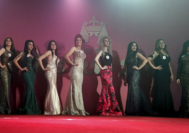 Participants wait for judges to determine the winner of Miss Iraq during the final round of judging in Baghdad, December 19, 2015