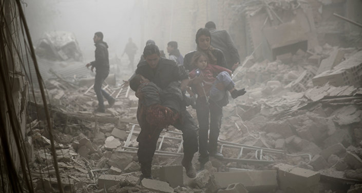 Syrians evacuate victims following air strikes on the town of Douma in the eastern Ghouta region, a rebel stronghold east of the capital Damascus, on December 13, 2015