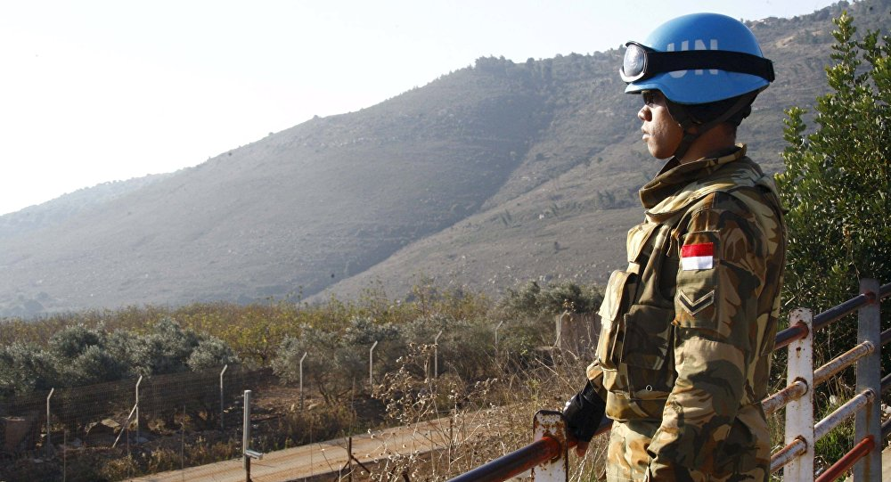 A UN peacekeeper of the United Nations Interim Force in Lebanon (UNIFIL) stands at a lookout point in Adaisseh village near the Lebanese-Israeli border, southern Lebanon December 21, 2015.