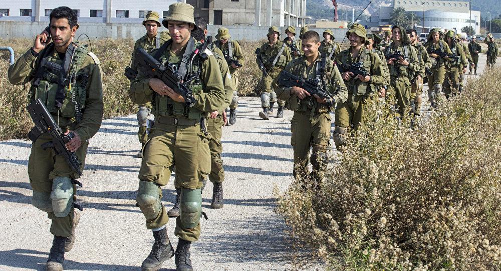 Israeli soldiers patrol the northern Israeli-Lebanon border