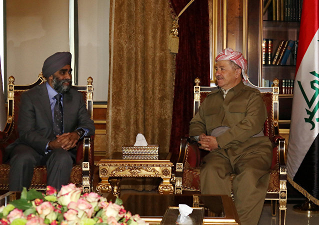 Canadian Minister of National Defence Harjit Sajjan (L) meets with Iraqi Kurdish leader Massud Barzani in Arbil, the capital of the Kurdish autonomous region in northern Iraq, on December 21, 2015.