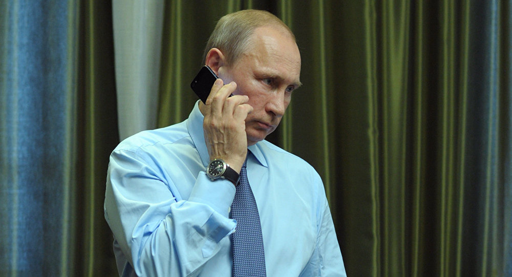 President Vladimir Putin talks over the phone.
