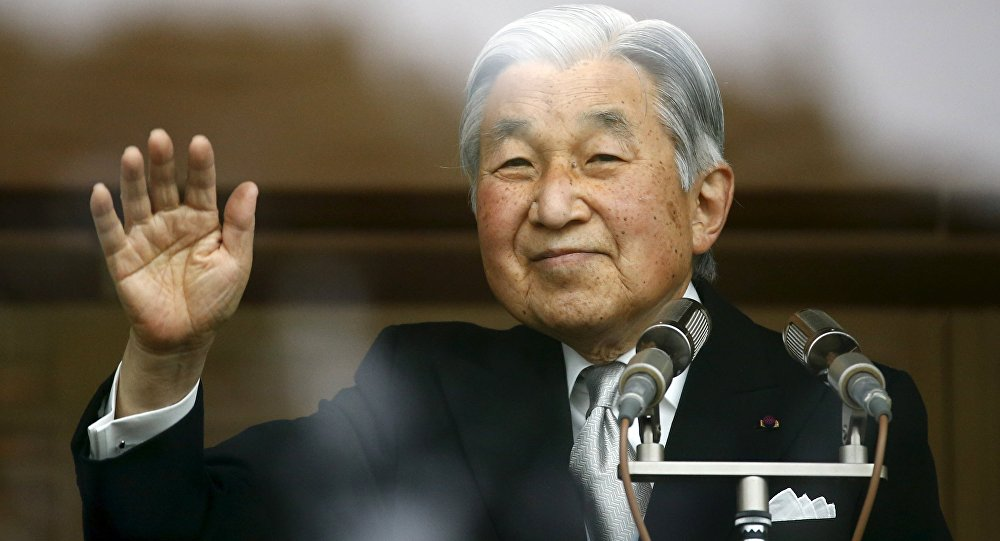 Japan's Emperor Akihito's waves to well-wishers who gathered at the Imperial Palace to mark his 82nd birthday in Tokyo, Japan