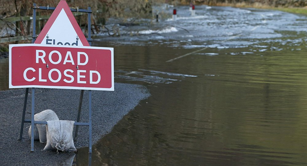 A road is closed due to flooding near the village of Pooley Bridge in North West England, December 10, 2015