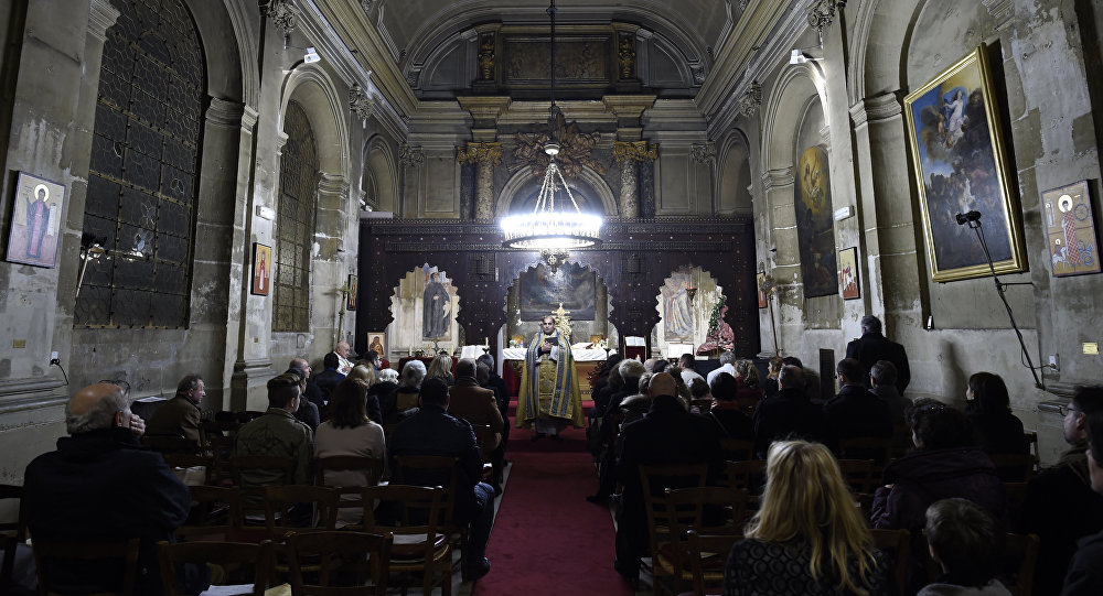 The faithfull attend a Christmas Eve mass at the Syriac Catholic Church of Saint Ephrem in Paris, on December 24, 2015
