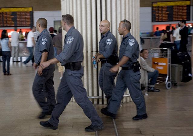 Israeli police officers walk through Ben Gurion airport near Tel Aviv , Israel